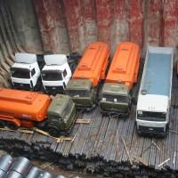 trucks-loaded-on-top-of-steel-billets